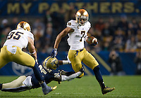 TJ Jones (7) carries the ball as Pittsburgh Panthers safety Jason Hendricks (25) defends in the first quarter.