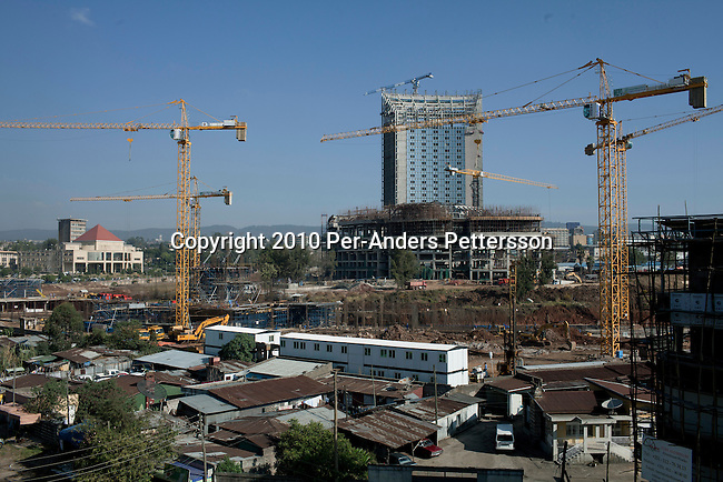 ADDIS ABABA, ETHIOPIA - NOVEMBER 17: Residents live next to the construction site of the new African Union Buildings on November 17, 2010 in Addis Ababa, Ethiopia. The building is built for free by the Chinese. Chinese companies are investing and working all over Africa and in Ethiopia they are mainly occupied with infrastructure projects around the country. To the left is the old AU building. (Photo by: Per-Anders Pettersson)