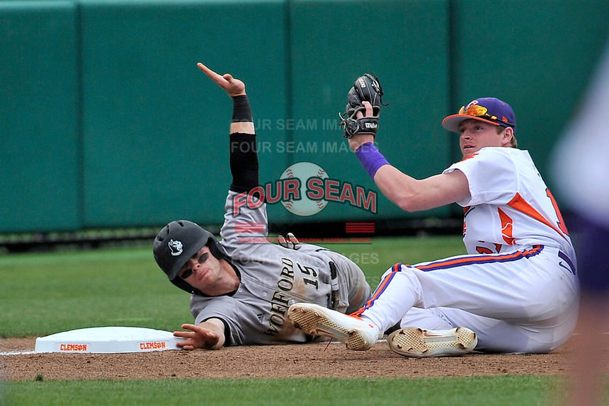 Second baseman Alec Paradowski (15) of the Wofford University Terriers is safe at third on a fly out in the first inning as third baseman Adam Renwick (11) of the Clemson University Tigers appeals to the umpire in a game on Tuesday, March 1, 2016, at Doug Kingsmore Stadium in Clemson, South Carolina. Clemson won, 7-0. (Tom Priddy/Four Seam Images)
