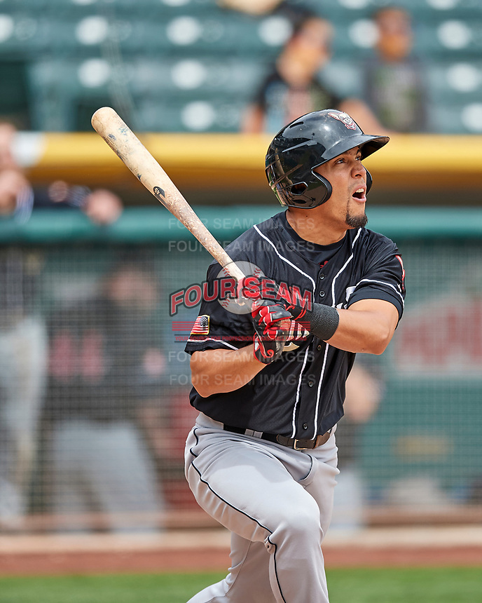 Rafael Ortega (13) of the El Paso Chihuahuas follows through with his swing against the Salt Lake Bees in Pacific Coast League action at Smith's Ballpark on April 30, 2017 in Salt Lake City, Utah.  El Paso defeated Salt Lake 3-0. This was Game 1 of a double-header. (Stephen Smith/Four Seam Images)