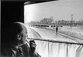 From his train car window, United States President Gerald R. Ford views the Soviet landscape on his arrival in Vladivostok, Union of Soviet Socialist Republics (U.S.S.R.) for talks with Soviet leaders on November 23, 1974.  A small party of Soviet aides and troops were at the station to meet President Ford's train.<br /> Mandatory Credit: David Hume Kennerly / White House via CNP