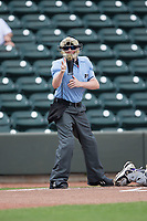 Home plate umpire Austin Jones makes a strike call during the Carolina League game between the Buies Creek Astros and the Winston-Salem Dash at BB&T Ballpark on April 16, 2017 in Winston-Salem, North Carolina.  The Dash defeated the Astros 6-2.  (Brian Westerholt/Four Seam Images)