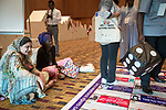 26 June, 2018, Kuala Lumpur, Malaysia : Rokhaya Ngom and  Hadiqa Bashir of Pakistan, watching her group play the Child Marriage Board game during a session at The Village on the second day at the Girls Not Brides Global Meeting 2018 at the Kuala Lumpur Convention Centre. Picture by Graham Crouch/Girls Not Brides