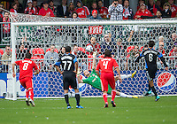 25 September 2010:  San Jose Earthquakes forward Chris Wondolowski #8 scores on Toronto FC goalkeeper Stefan Frei #24 with a penalty shot during a game between the San Jose Earthquakes and Toronto FC at BMO Field in Toronto..San Jose Earthquakes won 3-2..