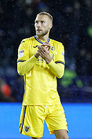 Mike van der Hoorn of Swansea City thanks away supporters during the Sky Bet Championship match between Sheffield Wednesday and Swansea City at Hillsborough Stadium, Sheffield, England, UK. Saturday 09 November 2019