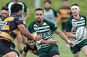 James Faiva flicks the ball on before Pat Masoe can make the tackle. Counties Manukau Premier Counties Power Club Rugby Round 4 game between Bombay and Manurewa, played at Bombay on Saturday March 31st 2018. <br /> Manurewa won the game 25 - 17 after trailing 15 - 17 at halftime.<br /> Bombay 17 - Ki Anufe, Chay Macwood tries, Tim Cossens, Ki Anufe conversions,  Ki Anufe penalty. <br /> Manurewa Kidd Contracting 25 - Peter White 2 , Willie Tuala 2 tries, James Faiva conversion,  James Faiva penalty.<br /> Photo by Richard Spranger.