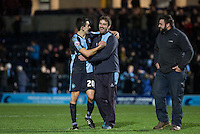 Luke O'Nien of Wycombe Wanderers with the WW Groundsman (centre) as the team claim victory during the Sky Bet League 2 match between Wycombe Wanderers and Oxford United at Adams Park, High Wycombe, England on 19 December 2015. Photo by Andy Rowland.