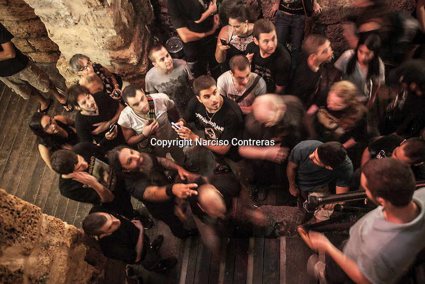 August 27, 2014 - Binyamina, Haifa District, Israel: Uri, bass player at Orphaned Land heavy metal band, is surrounded by fans asking for picture after he performed a concert in Binyamina Amphitheatre at north of Israel. Orphaned Land is a music band founded by Jewish and Arabian musicians who combine ethnic music with rock metal as they recite verses in Hebrew and Arabic from the sacred Quram and Tora Scriptures. (Narciso Contreras/Polaris)