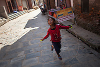 A young girl skips rope on the streets Kathmandu. 01 May 2013, © Nicolas Axelrod 2013