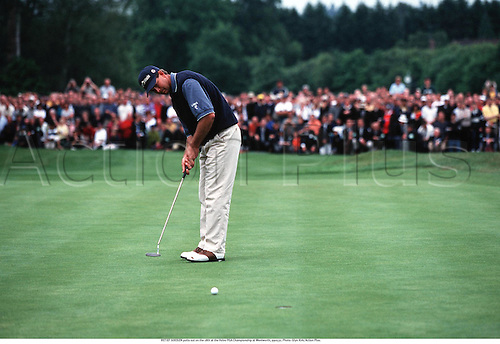 RETIEF GOOSEN putts out on the 18th at the Volvo PGA Championship at Wentworth, 990531. Photo: Glyn Kirk/Action Plus...1999.golf.golfer golfers.putt putting