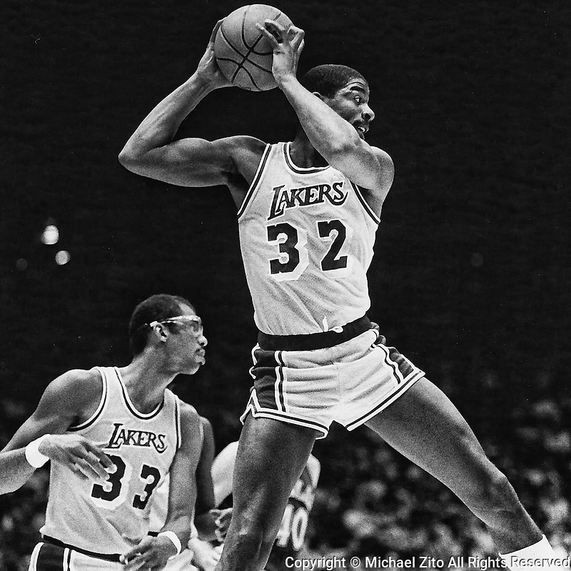Los Angeles, CA 1983 Los Angeles Lakers Magic Johnson grabs a rebound as Kareem Abdul Jabarr looks upcourt