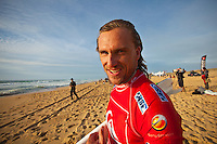 "Chris Davidson (AUS).  CULS NUS BEACH, Seignosse/France (Thursday, September 30, 2010) - The Quiksilver Pro France, event No. 7 of 10 on the 2010 ASP World Tour, was  called back ON this afternoon, recommencing with the fourth heat of Round 2 at 3pm.. .Consistent four-to-six foot (2 metre) waves were detonating across the sandbars of Culs Nus Beach this afternoon, providing the idea forum for the world's best to do battle in.. .""It's been a challenge today but the tide and swell have finally aligned for us to recommence competition at Culs Nus Beach at 3pm,"" Rich Porta, ASP International Head Judge, said. ""We are aiming at completing the remaining nine heats of Round 2.Photo: joliphotos.com"