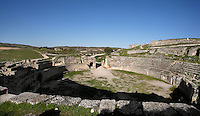 General view of Amphitheatre, 1st century AD, Segobriga, Spain, pictured on April 13, 2006, in the evening. The elliptical 74 m. long amphitheatre, seating almost 6,000, is well preserved. Its arena is separated from the auditorium by a podium and behind the scenes are areas for the animals, rooms for gladiators, and prayer rooms, all linked by a corridor. The spectacles would have included gladiatorial battles and fights with animals. It was in use until the 3rd century and then used as an agricultural store until the 17th century when it was damaged by being quarried for the Ucles Monastery. Segobriga was founded by the Romans in the 1st century BC, after the Punic wars, and the town was developed during the reign of  Augustus. It became an important administrative centre whose local industry was mining 'specularis lapis', a crystallized sheet gypsum used for window glass. Picture by Manuel Cohen.