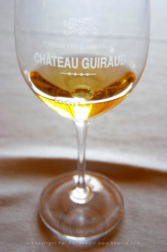 glass with wine chateau guiraud sauternes bordeaux france
