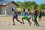 Dinka children play football in the Rhino Refugee Camp in northern Uganda. As of April 2017, the camp held almost 87,000 refugees from South Sudan, and more people were arriving daily. About 1.8 million people have fled South Sudan since civil war broke out there at the end of 2013. About 900,000 have sought refuge in Uganda.