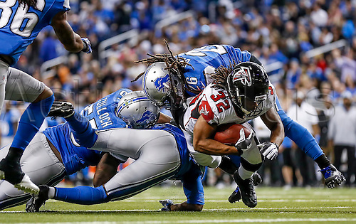 22.12.2012. Detroit USA.    Atlanta Falcons running back Michael Turner (33) battles with Detroit Lions free safety Louis Delmas (26) in game action.  The Atlanta Falcons defeated the Detroit Lions by the score of 31-18, at ford Field, in Detroit, Michigan.