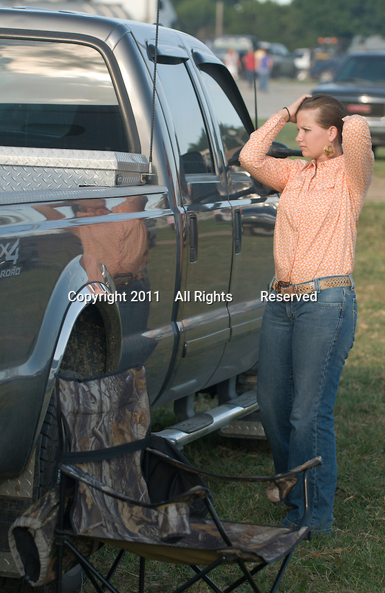 Johnsville, MD: J Bar W Ranch -- Katie Motter, Shippensburg, PA, checks her hair before the parade entrance at the beginning of the rodeo.