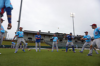 Tennessee Smokies players including Albert Almora (6), Elliot Soto (5), Kyle Schwarber (12), Billy McKinney (4) play two ball during a rain delay against the Montgomery Biscuits on May 25, 2015 at Riverwalk Stadium in Montgomery, Alabama.  Tennessee defeated Montgomery 6-3 as the game was called after eight innings due to rain.  (Mike Janes/Four Seam Images)