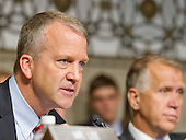 """United States Senator Dan Sullivan (Republican of Alaska) questions the witnesses during testimony before the United States Senate Committee on Armed Services concerning """"Impacts of the Joint Comprehensive Plan of Action (JCPOA) on U.S. Interests and the Military Balance in the Middle East"""" on Capitol Hill on Wednesday, July 29, 2015.<br /> Credit: Ron Sachs / CNP"""