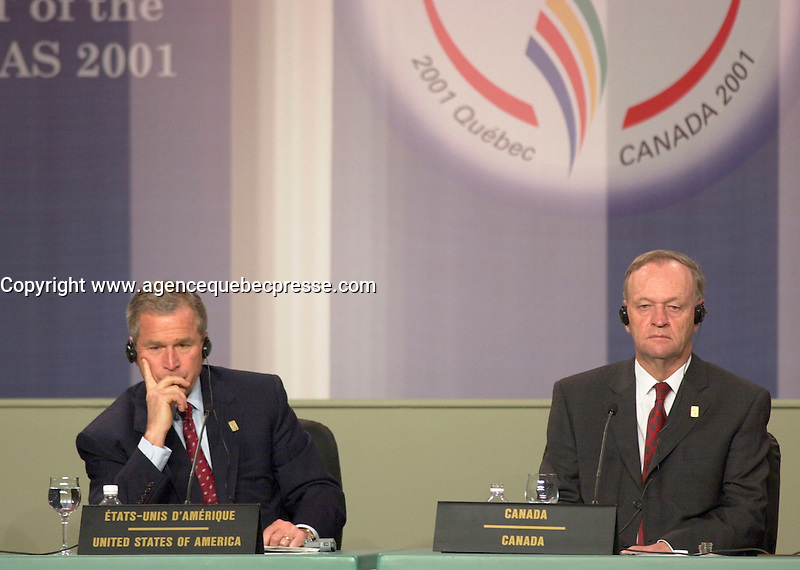April 22,  2001, Quebecl, Quebec, Canada<br /> <br /> George W, Bush, United States of Americas President (R) and Jean Chretien, Canada's Prime Minister (L) listen to a journalist's question at the closing press conference of the Summit of the Americas , April 22, 2001 in Quebec City, CANADA.<br /> <br /> Both leader agreed to meet before the upcoming G-8 meeting this spring in Alberta, Canada.<br /> <br /> Mandatory Credit: Photo by Pierre Roussel- Images Distribution. (&copy;) Copyright 2001 by Pierre Roussel <br /> ON SPEC<br /> NOTE l Nikon D-1 jpeg opened with Qimage icc profile, saved in Adobe 1998 RGB.