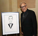 Ken Fallin with his drawing of John Mulaney attends 2017 Dramatists Guild Foundation Gala reception at Gotham Hall on November 6, 2017 in New York City.