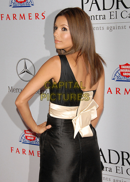 EVA LONGORIA.The 7th Annual El Sueno de Esperanza Benefit Gala to raise funds for Padres Contra El Cancer held at The Lot in West Hollywood, California, USA..October 18th, 2007.half length black dress cream sash waist hand on hip looking over shoulder bow ribbon .CAP/DVS.©Debbie VanStory/Capital Pictures