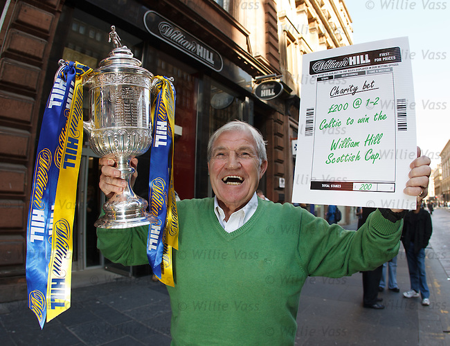 Bertie Auld with the Scottish Cup outside William Hills in Gordon Street, Glasgow