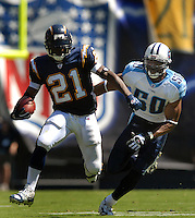 Sept. 17, 2006; San Diego, CA, USA; San Diego Chargers running back (21) LaDainian Tomlinson is pursued by Tennessee Titans linebacker (50) David Thornton at Qualcomm Stadium in San Diego, CA. Mandatory Credit: Mark J. Rebilas