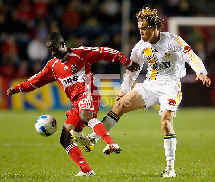 Los Angeles Galaxy midfielder Chris Albright (5) tries to knock the ball away from Chicago Fire midfielder Thiago (10).  The Chicago Fire defeated the Los Angeles Galaxy 2-1 at Toyota Park in Bridgeview, IL on September 23, 2006..