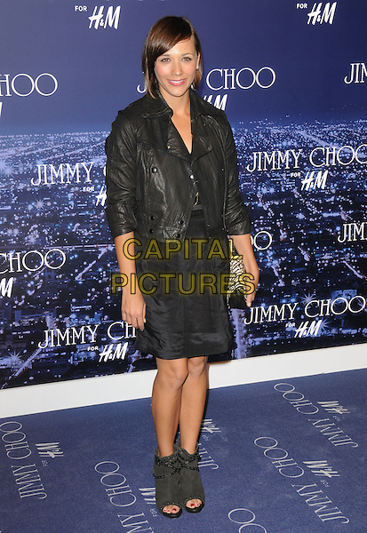 RASHIDA JONES .at The Jimmy Choo for H&M Launch Party in support of The Motion Picture & Television Fund held at  a private residence in West Hollywood, California, .USA, November 2nd 2009..full length black leather jacket dress open toe ankle boots clutch bag .CAP/RKE/DVS.©DVS/RockinExposures/Capital Pictures.