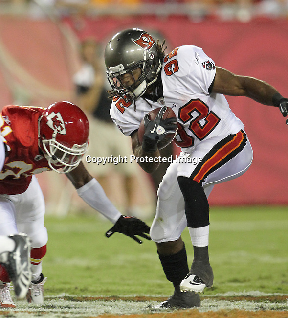 Tampa Bay Buccaneer's Kareem Huggins looks for running room against the Kansas City Chiefs. The Buccaneers defeated the Chiefs 20-15 during an NFL preseason game Saturday, Aug. 21, 2010 in Tampa,Fla. (AP Photo/Margaret Bowles).