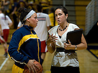 California assistant coach Kai Felton talks with Mikayla Lyles of California during the game against St. Mary's at Haas Pavilion in Berkeley, California on November 15th, 2012.  California defeated St. Mary's, 89-41.