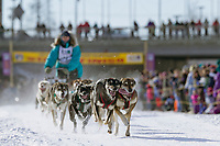 Musher Jeff Conn and dog team at the start of the oldest continuously run sled dog race in the world, the 2003 Open North American Sled dog championships which start on the Chena River in downtown Fairbanks, Alaska. The annual race consists of three daily races, the combined fastest time wins.