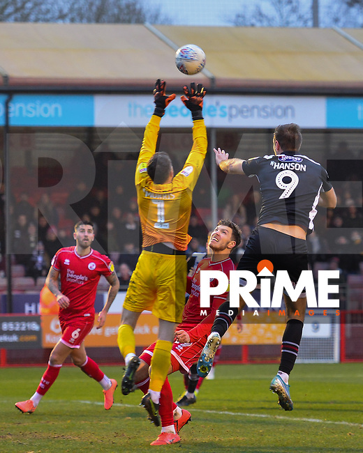 James Hanson in action against Glenn Morris during the Sky Bet League 2 match between Crawley Town and Grimsby Town at The People's Pension Stadium, Crawley, England on 25 January 2020. Photo by Lee Blease.