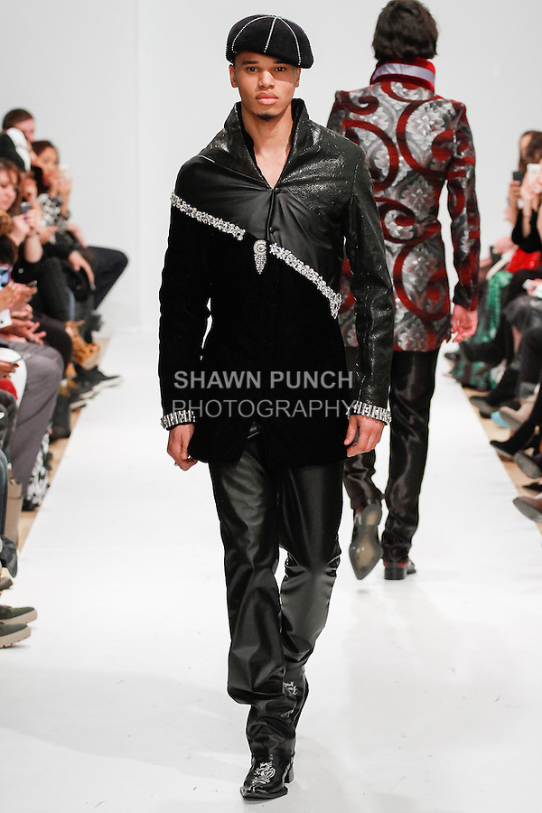 Model walks runway in an outfit from the Dexter Gill Fall 2014 collection, for Designer's Premier Fall Winter 2014, during New York Fashion Week Fall 2014, February 9, 2014.