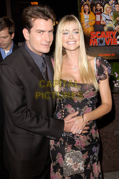 CHARLIE SHEEN & DENISE RICHARDS.attends the Scary Movie 3 L.A. Premiere held at the AMC Avco Cinema..hand on stomach.www.capitalpictures.com.sales@capitalpictures.com.©Capital Pictures.