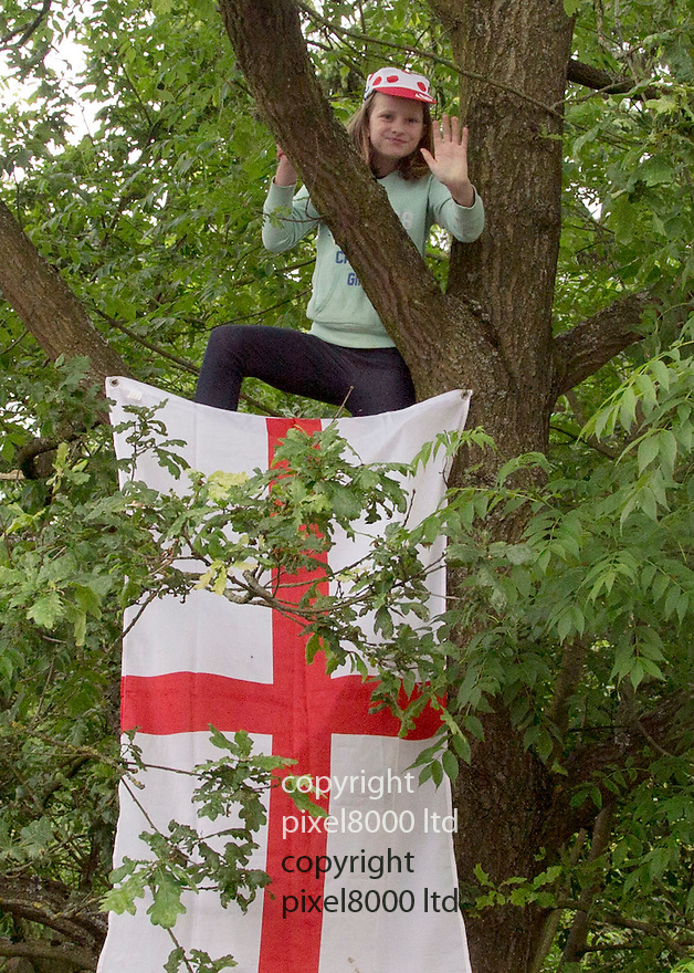 Grand Depart - Tour de France 2014<br /> Yorkshire England.<br /> Second stage passes through &quot;Blubberhouses Moor&quot;<br /> on the road from Harrogate<br /> Cycling fan -young girl climbed a tree for a view<br /> <br /> <br /> <br /> Pic by Gavin Rodgers/Pixel 8000 Ltd