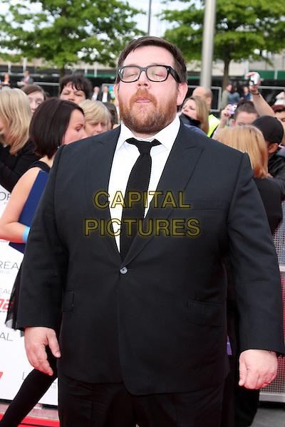 NICK FROST .National Movie Awards 2011 at Wembley Arena, London, England, UK, .May 11th 2011..half length black suit tie beard facial hair glasses funny tongue eyes shut .CAP/ROS.©Steve Ross/Capital Pictures