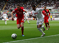 Pictured: Scott Sinclair of Swansea goes around Brendan Moloney on the wing<br />