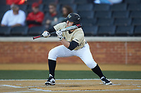 Michael Ludowig (22) of the Wake Forest Demon Deacons squares to bunt against the Gardner-Webb Runnin' Bulldogs at David F. Couch Ballpark on February 18, 2018 in  Winston-Salem, North Carolina. The Demon Deacons defeated the Runnin' Bulldogs 8-4 in game one of a double-header.  (Brian Westerholt/Four Seam Images)