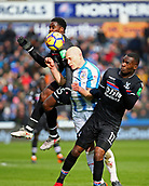 17th March 2018, The John Smiths Stadium, Huddersfield, England; EPL Premier League football, Huddersfield Town versus Crystal Palace; Aaron Mooy of Huddersfield Town feels the weight of Aaron Wan-Bissaka and Christian Benteke of Crystal Palace challenge