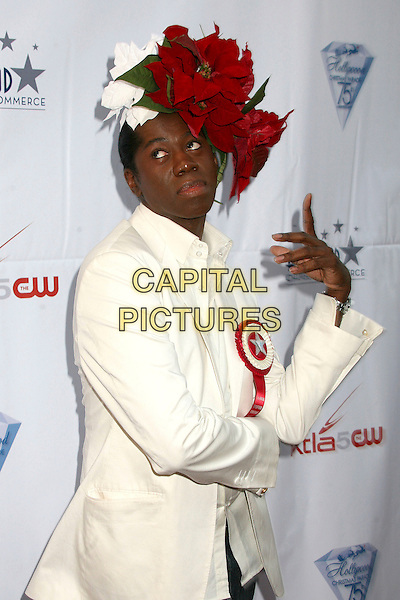 J. ALEXANDER.75th Annual Hollywood Christmas Parade at the Hollywood Roosevelt Hotel, Hollywood, California, USA, .26 November 2006..half length head piece flowers red leaves green rosette hat hands funny pose.CAP/ADM/BP.©Byron Purvis/Admedia/Capital Pictures