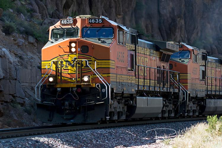 BNSF 4365, a GE C44-9W locomotive, leads an eastbound freight through Sawmill Canyon west of Kingman, Arizona.