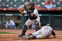 Catcher Francis Larson #20 of the UC-Irvine Anteaters waits for the ball as Nick Anders #2 of the Texas A&M Aggies slides into home plate in the 2009 Houston College Classic at Minute Maid Park February 27, 2009 in Houston, TX.  The Aggies defeated the Anteaters 9-2. (Photo by Brian Westerholt / Four Seam Images)
