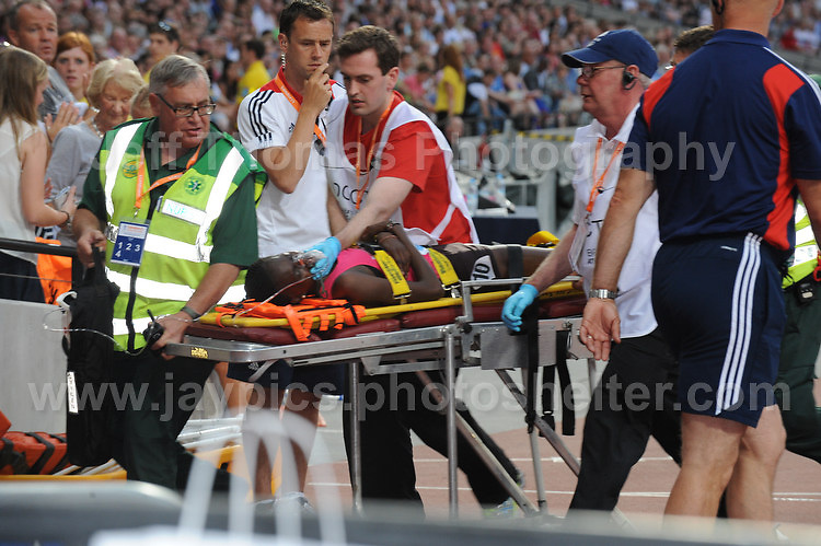 It's sad to see an athlete requiring assistance at the Sainsbury Anniversary Games, Olympic Stadium, London England,Saturday 27th July 2013-Copyright owned by Jeff Thomas Photography-www.jaypics.photoshelter.com-07837 386244. No pictures must be copied or downloaded without the authorisation of the copyright owner.
