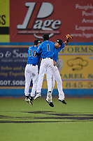 Hudson Valley Renegades center fielder Tanner Dodson (10), left fielder Bryce Brown (1) and right fielder Jordan Qsar (9) celebrate after a game against the Tri-City ValleyCats on August 24, 2018 at Dutchess Stadium in Wappingers Falls, New York.  Hudson Valley defeated Tri-City 4-0.  (Mike Janes/Four Seam Images)
