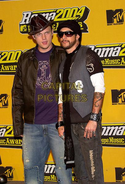 NICK CARTER & AJ McLEAN - BACKSTREET BOYS.MTV Europe Music Awards 2004.November 18th, 2004.half length, hats, sunglasses, shades, tattoos, vest, skull.www.capitalpictures.com.sales@capitalpictures.com.©Capital Pictures