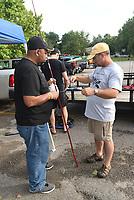 NWA Democrat-Gazette/FLIP PUTTHOFF<br />Arthur White (left) rigs a cane pole July 8 2017 for fishing at Lake Fayetteville.