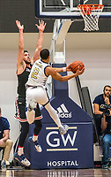WASHINGTON, DC - JANUARY 29: Jin Axel Gudmundsson #3 of Davidson tries to block a shot by Armel Potter #2 of George Washington during a game between Davidson and George Wshington at Charles E Smith Center on January 29, 2020 in Washington, DC.