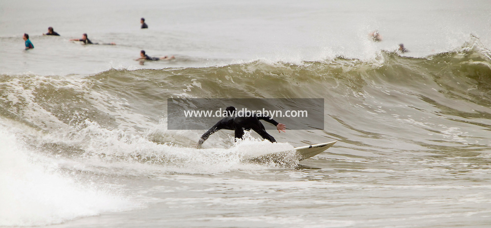 A surfeur rides a wave at Far Rockaway beach in New York, 17 September 2005.<br />